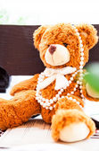 Fluffy toy bear with pearls — Stock fotografie