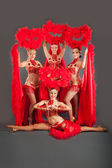 Young beautiful girls dancers in red dresses — Stok fotoğraf