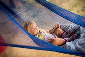Blonde baby girl in hummock — Stock Photo