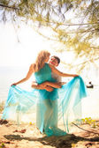 Young happy asian couple on island — Stock fotografie