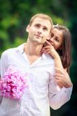 Brunette bride hugging her handsome groom — Stock Photo