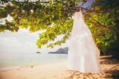 Beautiful wedding dress on island — Stock Photo