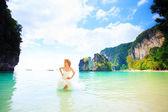 Blonde bride in sea water — Stock Photo