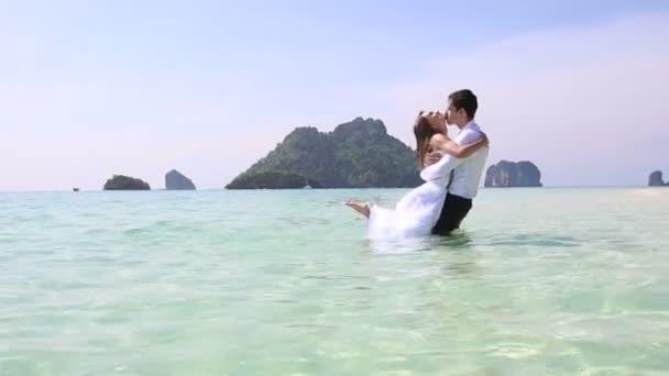 Bride and groom in water — Vidéo