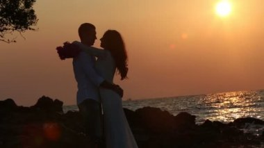 Bride and  groom  against sun rising — Stock Video