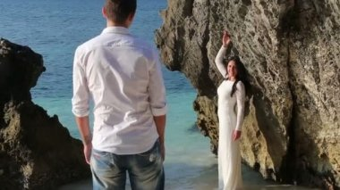 Bride in  shallow water and groom — Stock Video