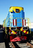 Colorful locomotive standing on rails — Stock Photo