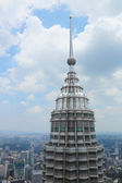 The top of Petronas in the clouds and blue sky, Kuala Lumpur, Malaysia, Asia — Stock Photo
