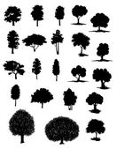 Vector silhouettes of assorted trees — Stock Vector