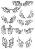 Set of outline heraldic wings — Stock Vector