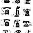 Silhouette of vintage telephones — Stock Vector #63804079