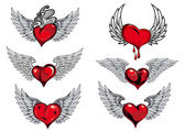 Winged heart icons and tattoos — Vector de stock