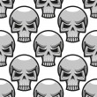 Seamless skulls pattern in cartoon style — Vecteur #64979457