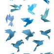 Origami paper stylized blue flying birds — Stock Vector #72540435
