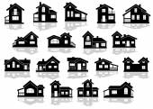 Black silhouettes of houses and cottages — Stock Vector