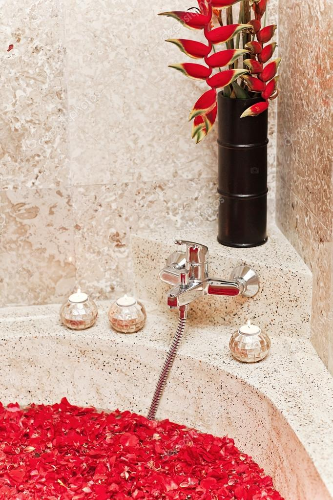 tropical red flowers in luxury hotel bath. spa decoration. relax