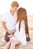 Lovely couple on sunset beach — Stockfoto