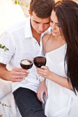 Tenderness couple with wine on sunset beach — Stockfoto