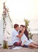 Tenderness couple on the beach picnic near wigwam — Stock Photo
