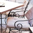 Garden furniture on italian narrow street in small town — Stock Photo #54573863
