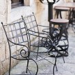 Garden furniture on italian narrow street in small town — Stock Photo #54573893
