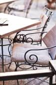 Garden furniture on italian narrow street in small town — Stock Photo