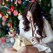 Happy young woman giving christmas present box — Stock Photo #54606045