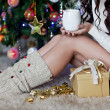 Happy young woman with a christmas cup of cacao — Stock Photo #54606069
