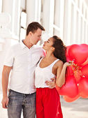 Teenage couple holding red baloons-hearts. valentine day — Stock Photo