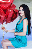 Beautiful brunette young woman with a heart-shaped balloons. Valentine's day. — Stock Photo