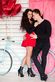 Beautiful couple in love with red balloon heart shape for valent — Stock Photo