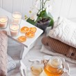 Tea-tray with hot grass drink, knitting clothes, dry oranges, ca — Stock Photo #63184901