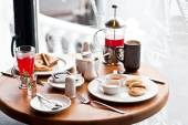 Breakfast for two in the cozy cafe on winter snowing morning. Ch — Stock Photo