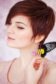 Young beautiful woman with exotic black and yellow butterflies — Stock Photo