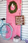 Valentine wreath and sign board on wooden vintage pink door — Photo