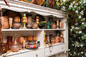 White sideboard with traditional handmade objects — Stock Photo
