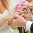 Groom putting ring on brides finger — Stockfoto #65711939