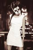 Day of the dead girl with sugar skull makeup — Stockfoto