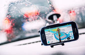 Smart phone with a Waze GPS navigator on the screen — Stock Photo