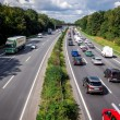Rush hour in a traffic jam with rows of cars — Stock Photo #53799985
