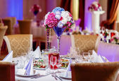 Luxury banquet table setting at restaurant — Stock Photo