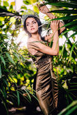 Beautiful woman in long evening dress and with tiara on a head — Foto de Stock