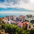 Picturesque view of Malaga bullring (La Malagueta) and seaport. — Stock Photo #67799111