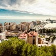 Picturesque view of Malaga bullring (La Malagueta) and seaport. — Stock Photo #67799175
