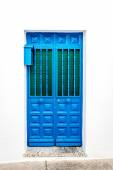 Blue door over white wall. Mijas, Andalusia. Southern Spain — Stock Photo
