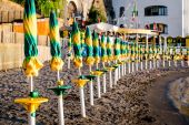 Closed parasols in a row  — Stock Photo