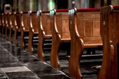 Wooden pews in a row in a church — Stock Photo