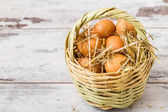 Brown Eggs in a Straw Basket — Stock Photo