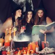 Постер, плакат: Witches look into the book tinted