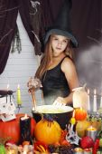 Witch throwing secret ingredient — Stock Photo